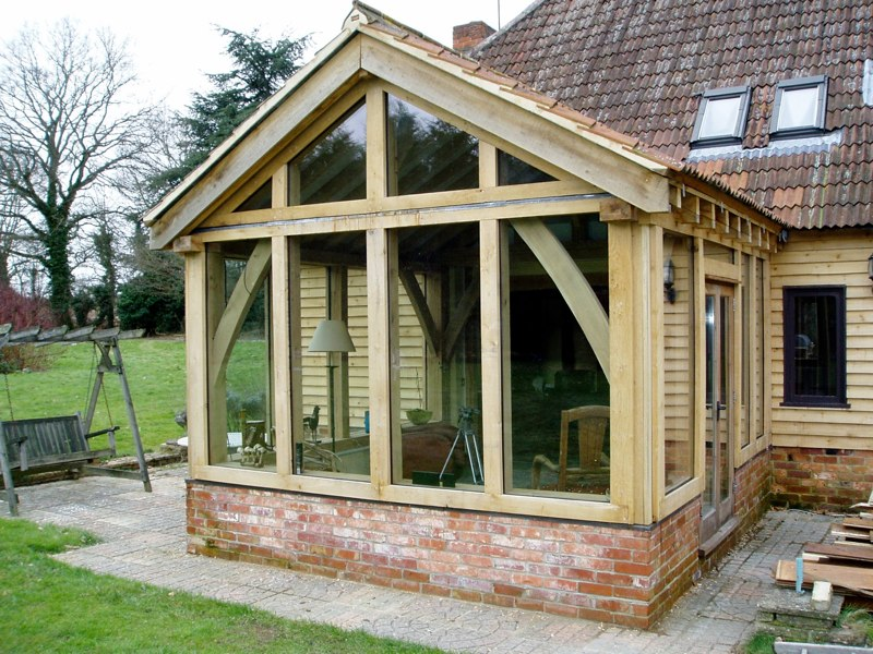 Single storey green oak frame living room extension for Garden rooms extensions designs