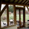Single storey green oak frame living room extension